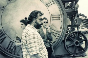 Matt Dillon and Mickey Rourke stand by the clock with lollipops as Coppola is in the foreground